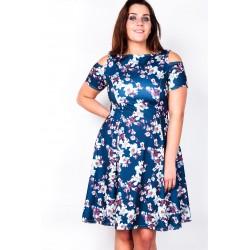Tumesinisel taustal lillemustriga kleit